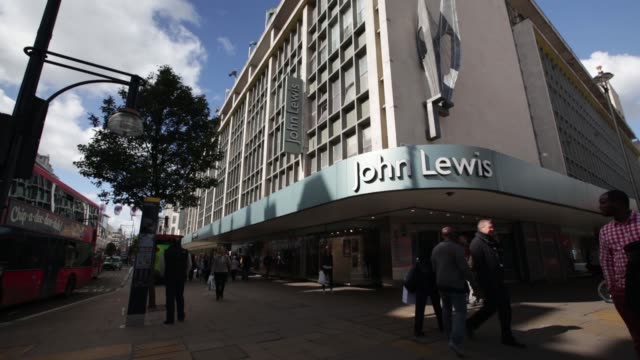 general views pedestrians pass a john lewis plc department store in london uk on monday sept 16 general views customers travel on escalators inside a... - plc stock videos & royalty-free footage