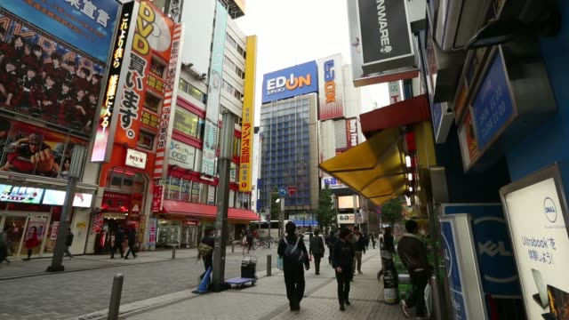 general views people shop at electronics parts stores in the akihabara district in tokyo japan on thursday nov 14 general views pedestrians and... - shop sign stock videos and b-roll footage