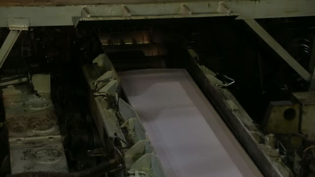 general views rolls of sheet aluminum sit on the production line at the akao aluminum co plant in tokyo japan on monday feb 17 a sheet of aluminum... - aluminum sheet stock videos and b-roll footage