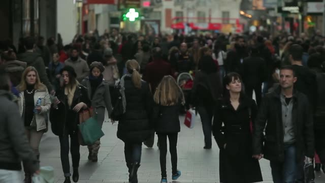 vídeos de stock e filmes b-roll de general views shoppers carry their purchases in shopping bags on the first day of sales in madrid, spain, on tuesday, jan. 7 pedestrians walk past a... - sale