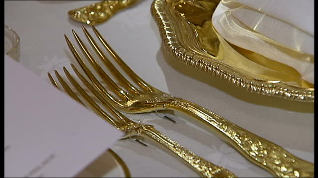 general views table set for banquet including close up of table settings footman rows of chairs and place settings - フットマン点の映像素材/bロール