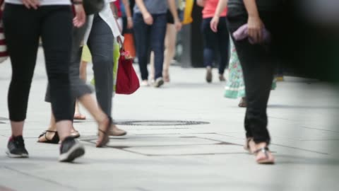 stockvideo's en b-roll-footage met general views the legs of shoppers walking along a busy shopping street in frankfurt, germany, on thursday, july 17 two shoppers stand talking... - shopping centre