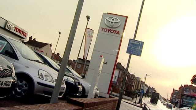 stockvideo's en b-roll-footage met general views toyota cars outside toyota garage toyota badge on car and toyota car inside garage toyota car driven onto forecourt and 'toyota' sign... - toyota motor
