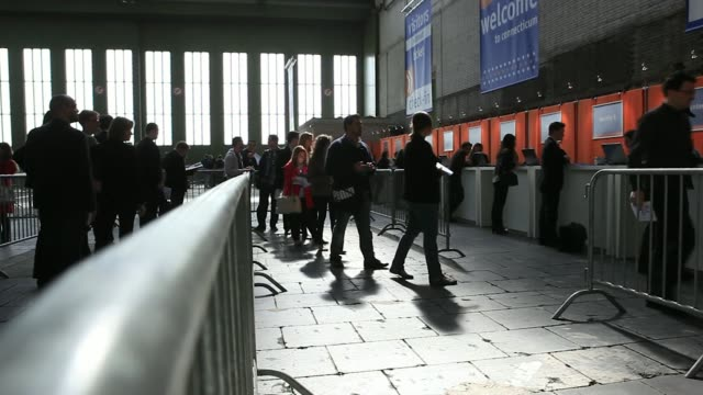 stockvideo's en b-roll-footage met general views visitors queue to enter the connecticum job fair for students graduates and young professionals at tempelhof airport in berlin germany... - banenbeurs