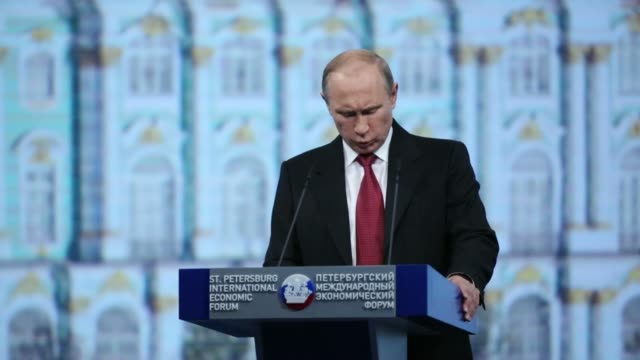 general views vladimir putin, russias president, speaks during the plenary session of the st petersburg international economic forum in saint... - 2014 stock-videos und b-roll-filmmaterial