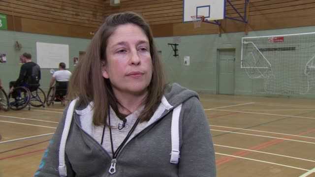 general views wheelchair basketball team england int ann wild interview sot / gvs paralympic basketball players playing on court including captain... - wheelchair basketball stock videos and b-roll footage