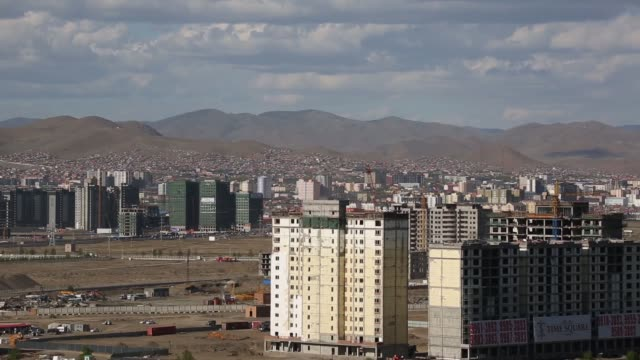 General views workers labor on the construction site of a residential building in Ulaanbaatar PAN LR High angle views commercial and residential...