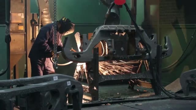 general views workers use burners to smooth off the surfaces of bogie trolley components during wagon manufacture at the tikhvin freight car building... - fahrgestell stock-videos und b-roll-filmmaterial