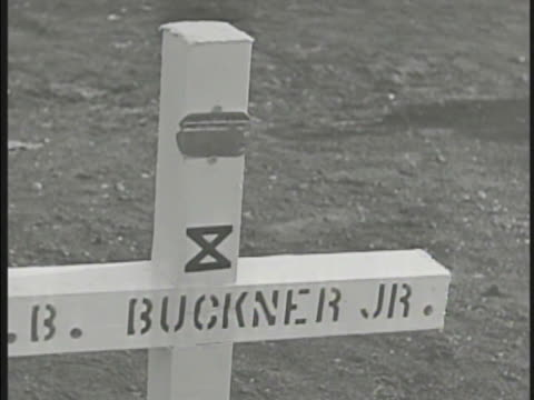 general visiting grave of general simon bolivar buckner jr ms soldier playing 'taps' on bugle soldiers walking 10th army cemetery filled w/ white... - bugle stock videos and b-roll footage
