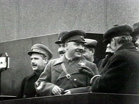 general voroshilov putting glasses on to read his speech, mikoyan, kaganovich can be seen as well audio / moscow, russia - anno 1935 video stock e b–roll