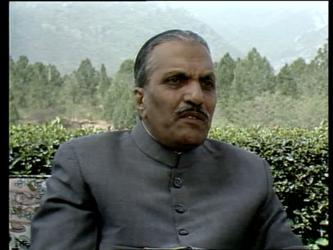 general zia interview on withdrawal of soviet troops from afghanistan pakistan ext ms sandy gall and general zia along through grounds of residence... - zia stock videos & royalty-free footage