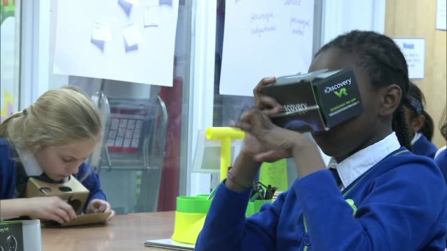 vídeos de stock e filmes b-roll de generation beyond project encourages stem careers with imaginary mission to mars; england: london: int various of school children using cardboard... - stem assunto