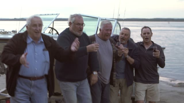stockvideo's en b-roll-footage met generatie mature five brothers fishing trip big river - levensecht