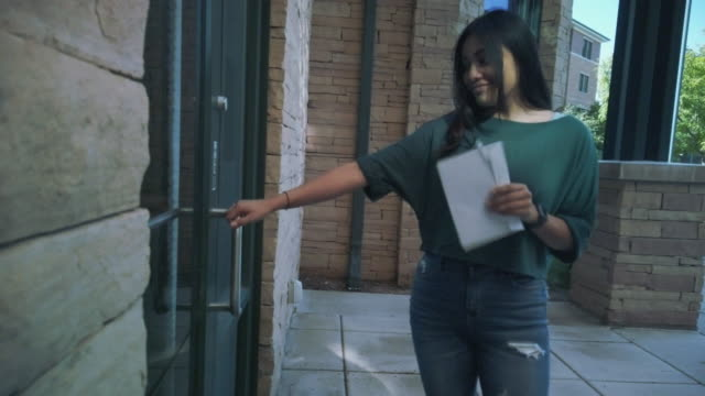 generation z hispanic female voter with mail-in voting election ballot in western usa 4k video series - united states postal service stock videos & royalty-free footage