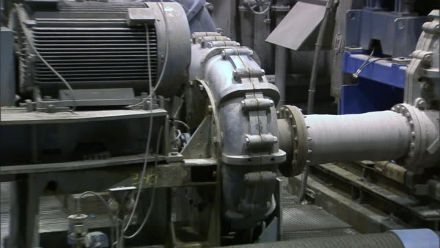 a generator operates in a room full of pipes and other equipment. - generator stock videos and b-roll footage