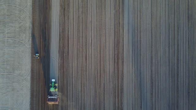 generic aerial shot of tractor moving through farmland on june 3, 2017 in dufferin,ontario, canada - ontario canada stock videos & royalty-free footage