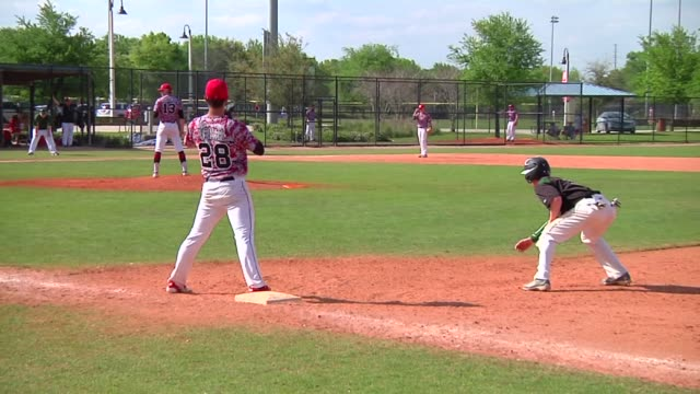 stockvideo's en b-roll-footage met generic baseball broll shot in florida during major league baseballs spring training season close up shot of a baseball team watching the game from a... - honkbalspeler