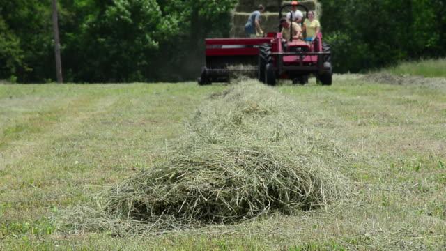 generic farming, tractor baler on a farm - hay baler stock videos & royalty-free footage