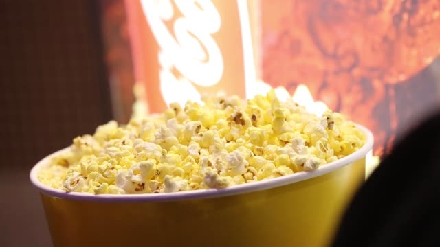 Generic footage of popcorn being prepared for sale at Regal Cinemas LA LIVE 14 in Los Angeles CA on APril 21 2017 Shots CU of popcorn signage all...