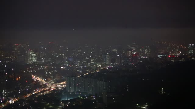Generic footage of Seoul South Korea on October 7 2015 Shots wide shot of biking lane on bridge man stands silhouetted against city at night wide pan...