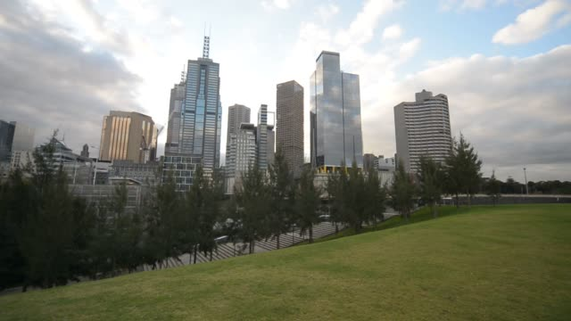 Generic footage of the city of Melbourne Australia on August 7 2015 Shots 360 degree pan of open grassy area and city wide shot of landscape and...