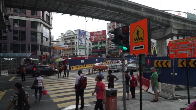 Generic Footage of traffic and pedestrians in Kuala Lumpur Malaysia on September 29 2015 Shots wide high angle shot of residential area cityscape on...