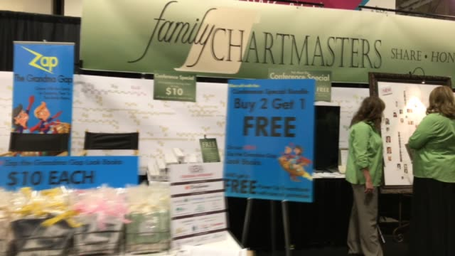 Generic handheld continous footage of various booths and attendees at the 2017 RootsTech Conference in Salt Lake City UT on February 9 2017 Shots...
