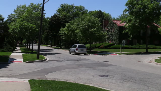 generic suburban homes and street scene - illinois stock-videos und b-roll-filmmaterial