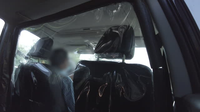 generic taxi interior with plastic separation during coronavirus covid-19 pandemic - taxi stock videos & royalty-free footage