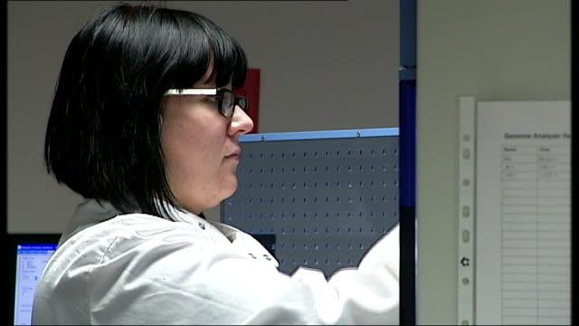 genetics laboratory; england: yorkshire: leeds: int various shots of female scientist - laboratory technician carrying out tests on liquids in... - genetisk forskning bildbanksvideor och videomaterial från bakom kulisserna