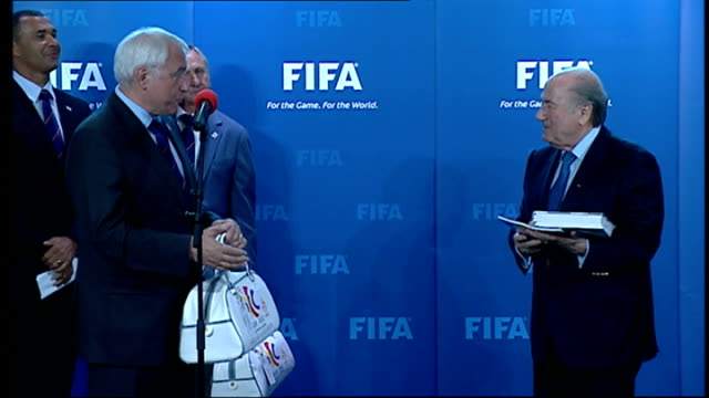 bid spokesman handing over bag to sepp blatter at bid ceremony member of qatar royal family speaking at bid ceremony - spokesman stock videos & royalty-free footage