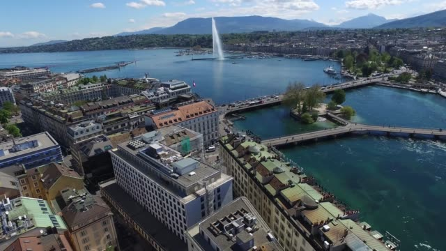 "vídeos de stock e filmes b-roll de geneva - switzerland on sunny summer afternoon, from the left-bank, over ""cornavin"" district. featuring the landmark water fountain, symbol of the city. aerial drone footage - switzerland"