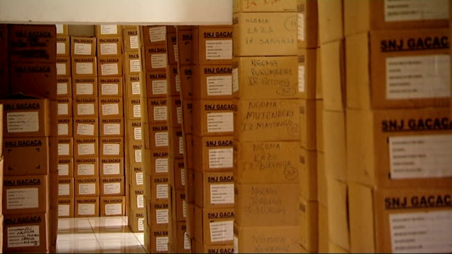 twentieth anniversary int shot through secure warehouse with shelves of files containing details of the genocide trials gvs boxes of evidence... - völkermord stock-videos und b-roll-filmmaterial