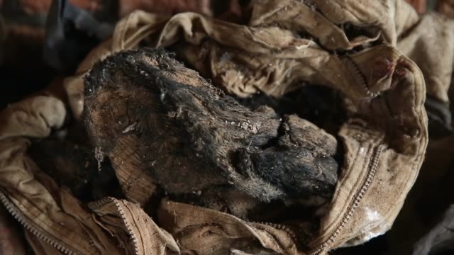 cu genocide victims' bloodstained clothing possessions and bones are on display inside the nyamata catholic church memorial ahead of the 20th... - völkermord stock-videos und b-roll-filmmaterial