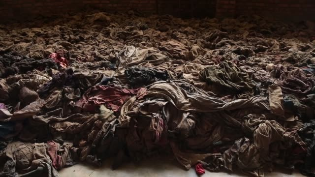 ws genocide victims' bloodstained clothing possessions and bones are on display inside the nyamata catholic church memorial ahead of the 20th... - genocide stock videos & royalty-free footage