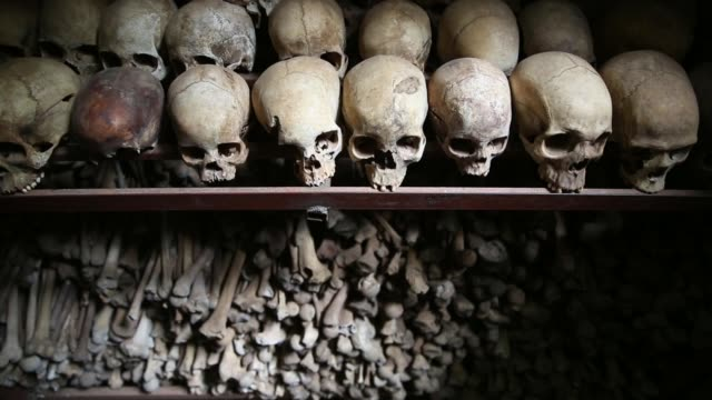 ms genocide victims' bloodstained clothing possessions and bones are on display inside the nyamata catholic church memorial ahead of the 20th... - völkermord stock-videos und b-roll-filmmaterial