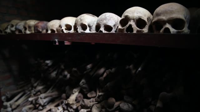 ms genocide victims' bloodstained clothing possessions and bones are on display inside the nyamata catholic church memorial ahead of the 20th... - memorial stock videos & royalty-free footage