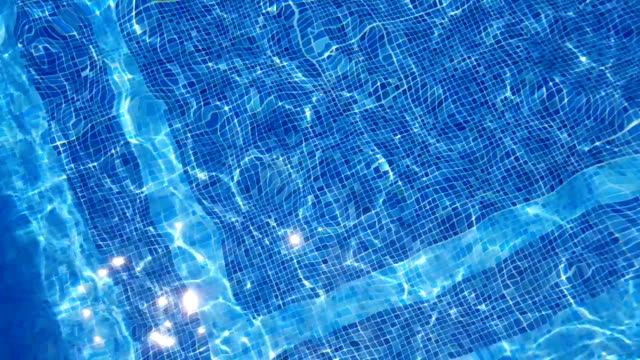 gentle ripples of a swimming pool - tile stock videos & royalty-free footage