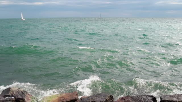 gentle waves crash against rocks - waterfront stock videos & royalty-free footage