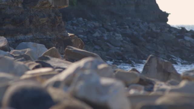 Gentle waves hit rocks on Newcastle's coastline, New South Wales, Australia.