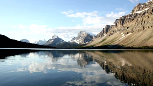 gentle waves lap surface of mountain lake - origins stock videos & royalty-free footage