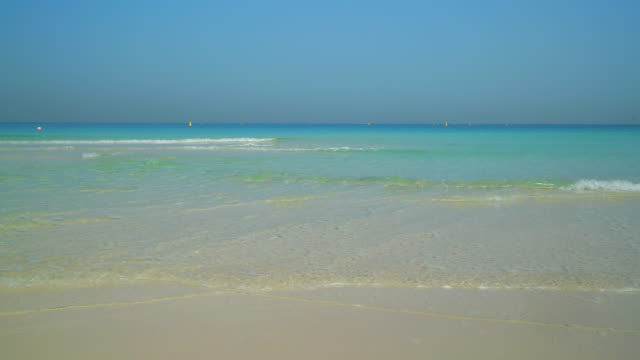 gentle waves lapping a beach, dubai - sunny stock videos & royalty-free footage