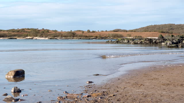 gentle waves on a beach in south west scotland - general view stock videos & royalty-free footage