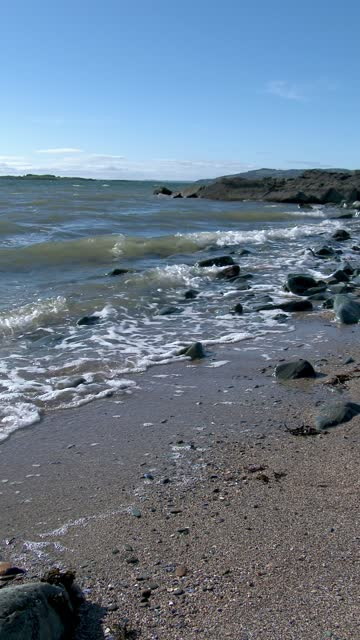 gentle waves on a scottish beach in spring - general view stock videos & royalty-free footage