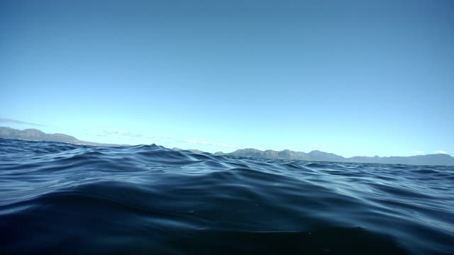 gentle waves roll on the indian ocean. - indian ocean stock videos & royalty-free footage
