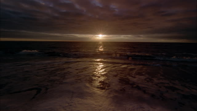 gentle waves wash onto a beach. - sylt stock videos & royalty-free footage