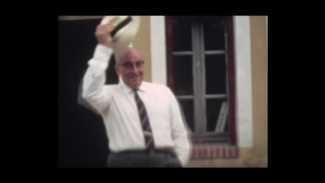 vidéos et rushes de 1967 gentleman doffs his hat and approaches wife - chapeau