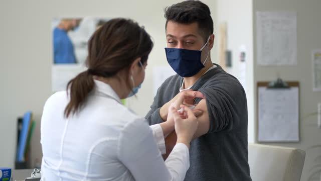 gentleman receiving the covid-19 vaccine - canada stock videos & royalty-free footage