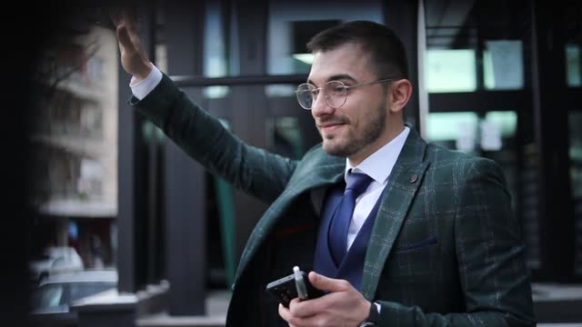 gentleman wtih eyeglasses. a businessman in front of an office building. handsome businessman - handsome people stock videos & royalty-free footage