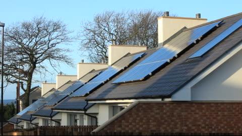 gentoo house builder's hutton rise housing development in sunderland, uk. hutton roof sets new standards in green build. many of the houses are zero carbon, highly thermally efficient and incur minimal running costs. this passivehaus has 300mm wall cavitie - rooftop stock videos & royalty-free footage